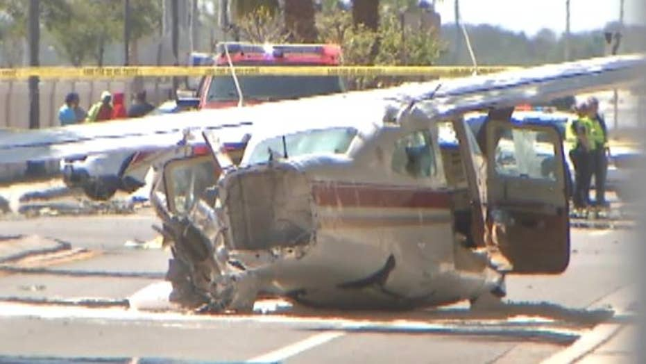 Small plane crashes into street nearly hitting cars
