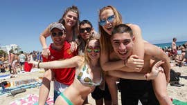 Despite new rules, collegians are by no means slowing down their fun in the sun.