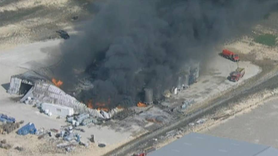Firefighters battle blaze after explosion at chemical plant