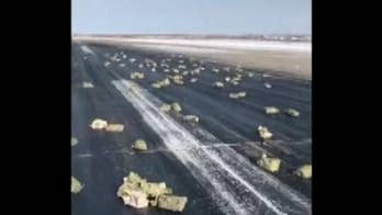 Over three tons of gold falls from a cargo plane after a hatch accidentally opens up during takeoff in Siberia. The incident left the runway scattered with the precious metal. The plane was carrying a total of $156 million worth of gold.
