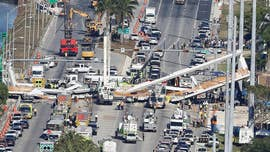 Construction of the pedestrian bridge that collapsed and killed six people in the Miami area was behind schedule and millions over budget, in part because of a key change in the design and placement of one of its support towers.