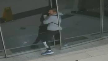 Melbourne Crime Investigation Unit has released security camera footage that shows a suspected burglar becoming stuck after forcing open a sliding glass door.