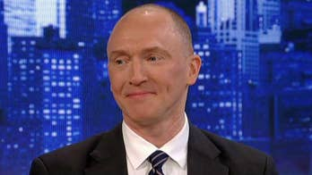 Justice Department considers releasing of part of the secret order that led to the surveillance of Trump campaign volunteer Carter Page.