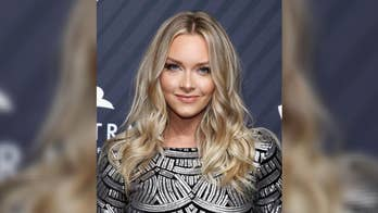 Sports Illustrated Swimsuit model Camille Kostek heats up in bikini snaps