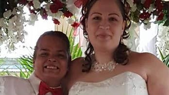 A couple holds a Walmart wedding to celebrate their office romance. Check out the photos of their special day.