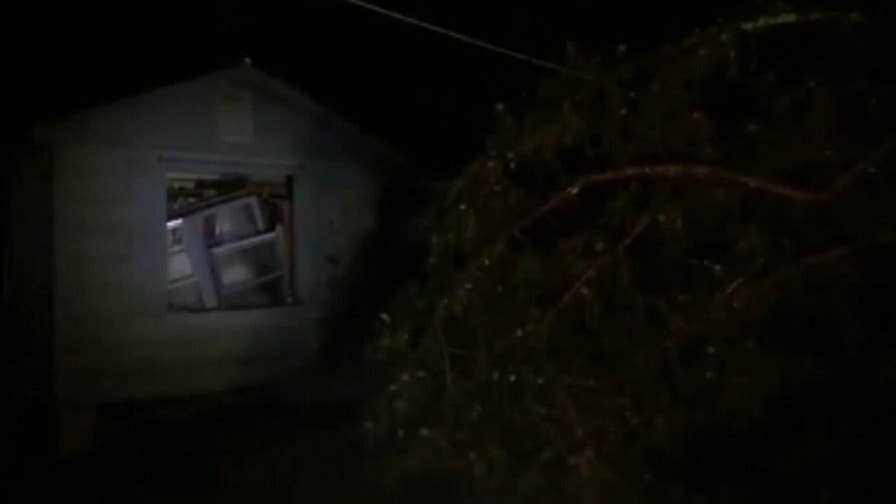 Raw video: The storm's powerful winds damaged homes, uprooted trees.