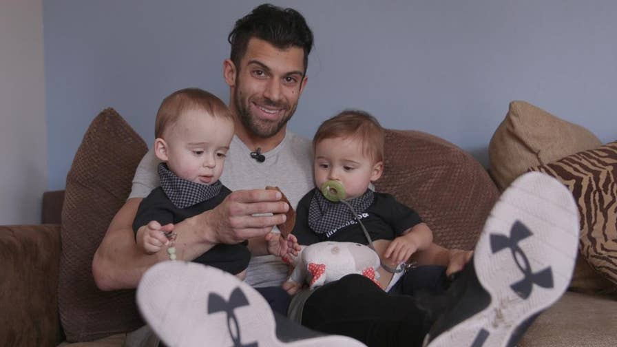 """Professional wrestler Rob Strauss or better known as """"Robbie E.""""  knows a thing or two about staying fit. That's why this father of 15-month-old twin boys avoids the dad bod by combining play time with pump time, and uses his 20-pound sons as weights."""