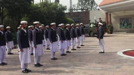 Deep in the mountainous terrain of Pakistan's Federally Administered Tribal Areas just miles from the Afghan border, around a dozen men - from their early 20s to their late 50s - salute and stamp to their national anthem.
