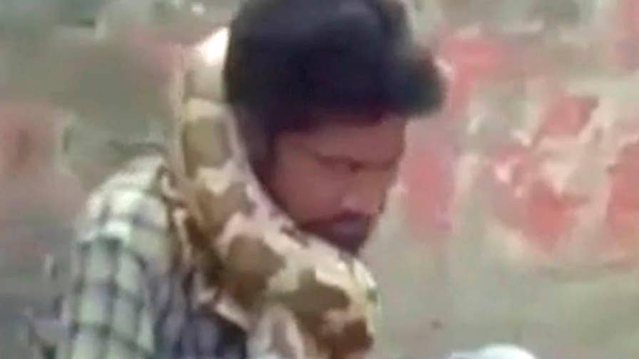 WATCH: A snake charmer's live show in Uttar Pradesh, India went horribly wrong when his deadly python strangled him in front of his audience.