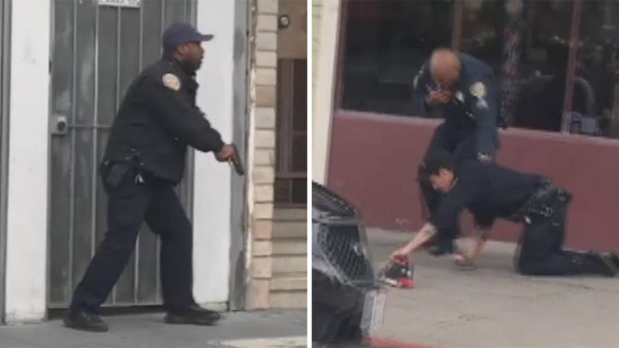 San Francisco police say five people were hit in addition to the officer, including the armed suspect they were responding to.
