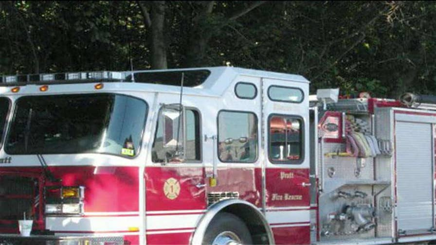 Officials are saying the firetruck hit a rock wall while responding to a separate fatal crash.