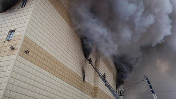 Russian investigators: Fire exits of mall were blocked, PA system was off. Benjamin Hall reports.