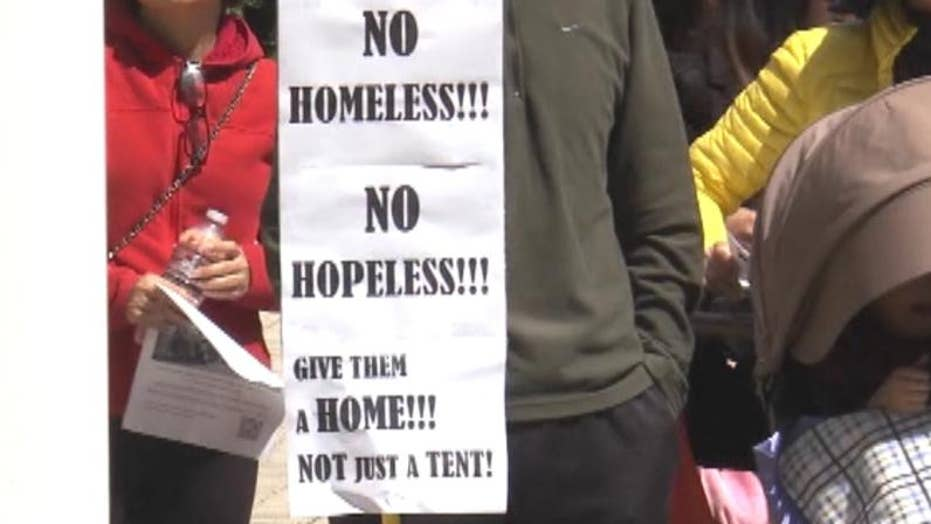 Irvine residents hold rally against homeless encampments