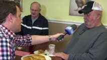 Todd Piro chats with diners in Manchester, Iowa.