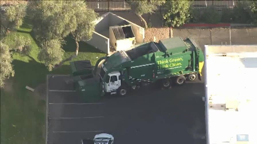 A homeless woman is in critical condition after she was dropped into a compacting garbage truck while sleeping in a dumpster in Phoenix, Arizona.