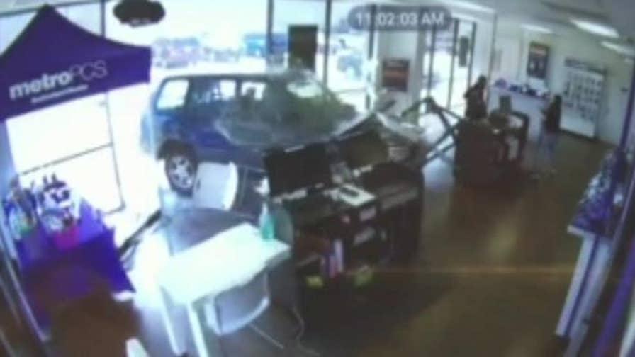 Surveillance footage shows a driver crashing into a MetroPCS store in Dallas, Texas.