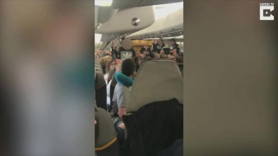 Five British men, apparently on a bachelor party, were arrested and escorted off their Las Vegas bound flight after disorderly conduct.  According to witnessed they refused to settle down, buckle up, and began fighting with each other. Watch as the plane cheers as they were walked off.