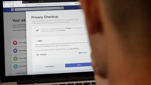 Reacting to backlash over data sharing scandal, Facebook's chief privacy officer says the social network is changing its design so users can more easily manage their privacy settings.