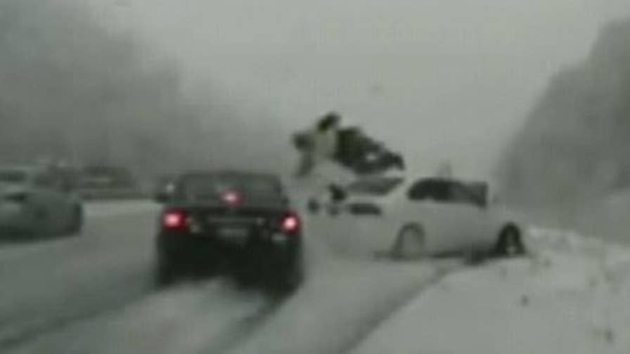 Raw video: Trooper Cade Brenchley was assiting a disabled vehicle when he was hit by a car sliding on the icy highway.