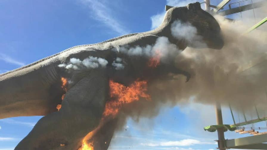 Raw video: Animatronic T-Rex catches fire in Dinosaur Wild Walk, an outdoor walking trail in Canon City, Colorado.