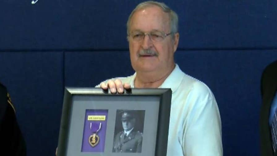 A Tucson police officer recovered a Purple Heart that was awarded to a WWI veteran from a local pawnshop, reuniting it with the colonel's family.