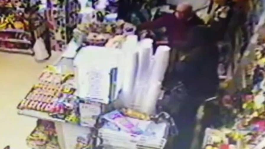 Raw video: Surveillance camera captures man attacking gas station employee during robbery in Burlington.