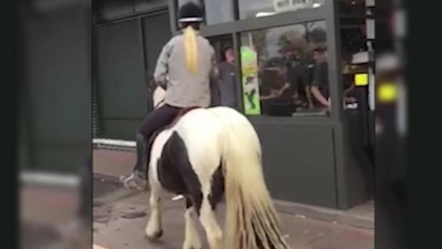 Caught on camera: While out for a stroll, 15-year-old Wallace Cruickshank wanted to give her horse a snack so she went through the McDonald's drive-thru.