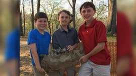 Three boys unearthed a fossil that could be nearly 100,000 years old all while playing near their backyard in a plowed area.