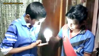 Video shows 9-year-old boy lighting LED bulb with his bare hands