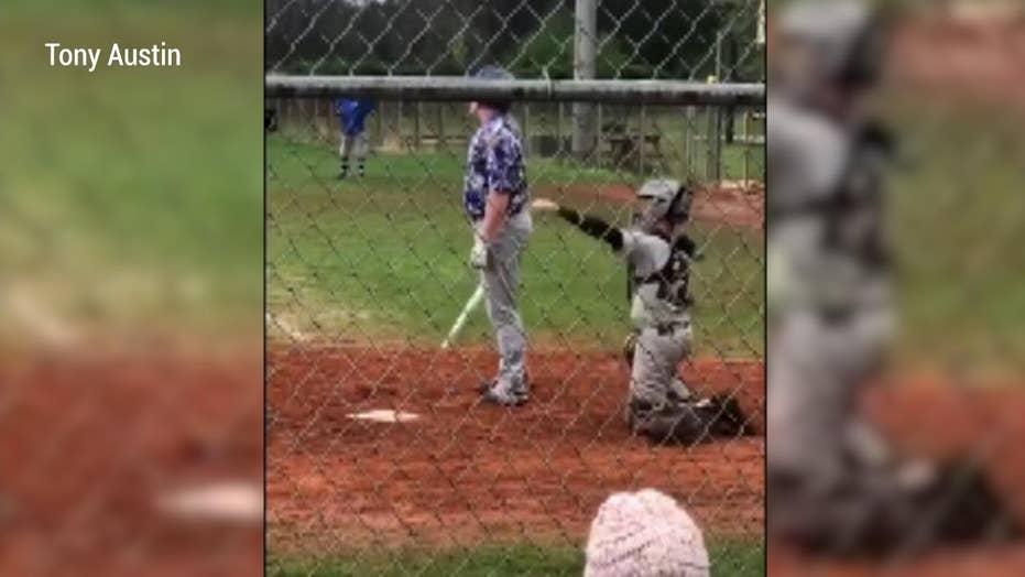 Watch: One-armed high school baseball catcher inspires