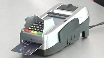 In an effort to make credit card transactions easier and faster, companies like Mastercard, Visa, American Express and Discover are phasing out the need for signatures at the register; David Lee Miller reports from New York.