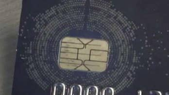 Credit companies say security chips have made transactions safer; David Lee Miller reports from New York.