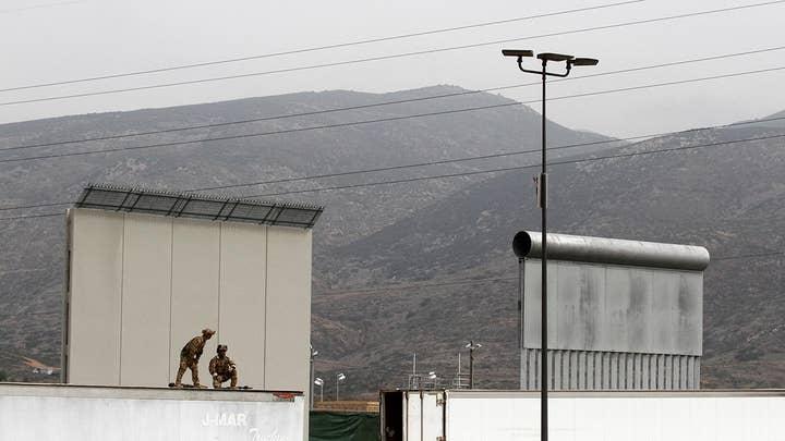 Does migrant caravan justify building a wall?