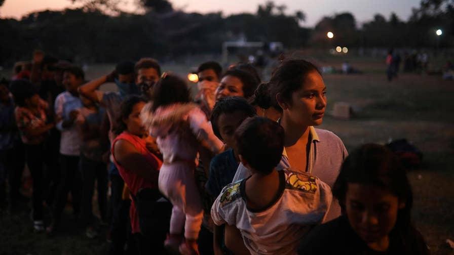 Migrant worker caravan stalls short of U.S. border.