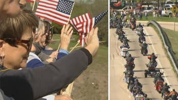 Veterans and first responders escort group of 21 Medal of Honor recipients while onlookers wave patriotic signs and flags in North Texas.