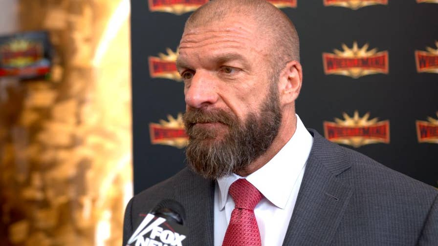 WWE star and Executive Vice President Triple H weighs in on the positive economic impact WrestleMania has on host towns and counties, as well as what signing Ronda Rousey means to the rest of the organization.