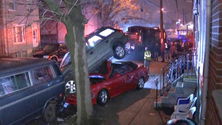 Philadelphia trash truck smashes row of parked cars