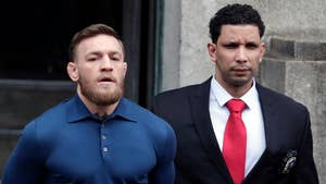 Raw video: UFC fighter Conor McGregor leaves Brooklyn precinct after being charged in brawl that left two people injured.