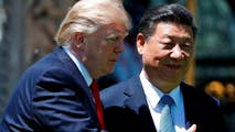 US and China exchange tariff threats