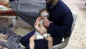 Assad regime denies responsibility after suspected chemical attack in rebel-held city near Syria's capital.
