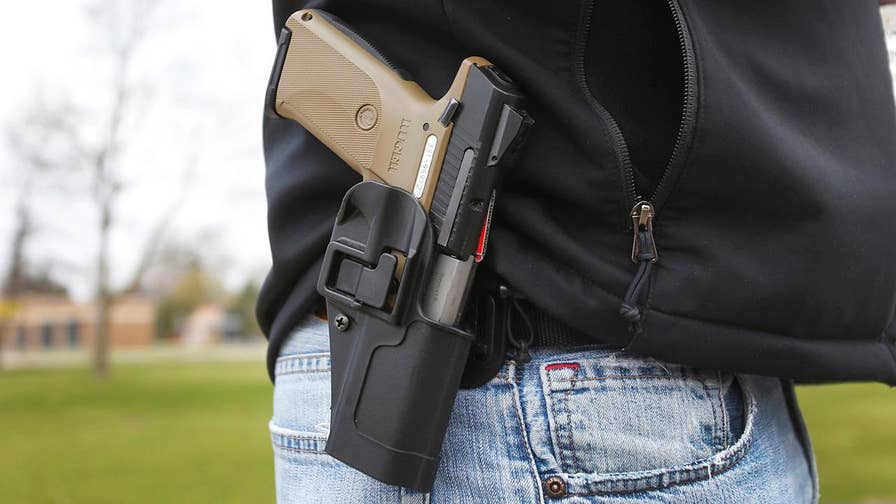 Public schools want right to set own guidelines when it comes to open carry and concealed weapons in their buildings; gun proponents say that violates state law.