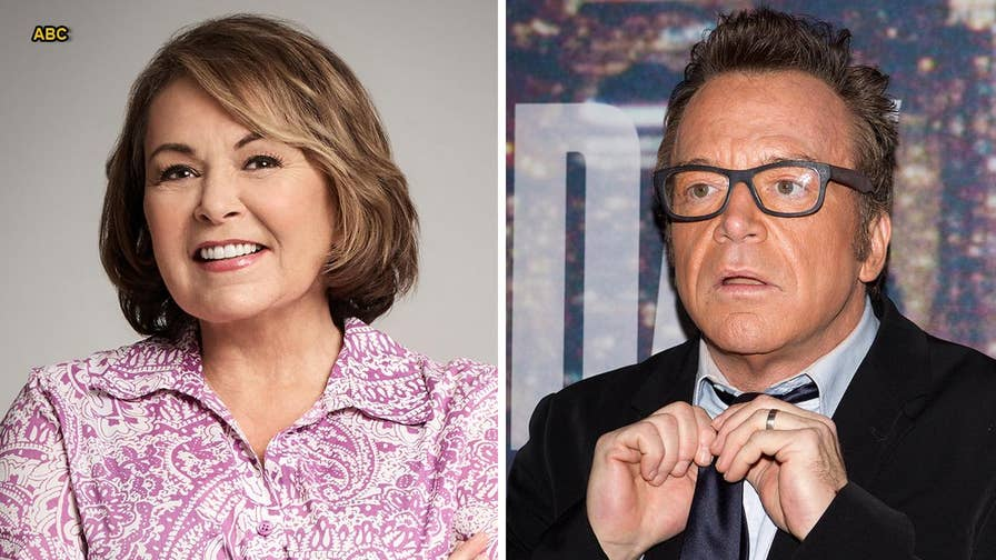 Tom Arnold is demanding his ex-wife Roseanne Barr, and ABC which airs her TV show 'Roseanne,' apologize for promoting what he calls 'insane' conspiracy theories.