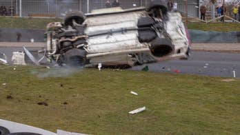 Shocking photos show a race car crashing and barrel-rolling across the track. Miraculously the driver walked away from the 100mph accident unscratched.