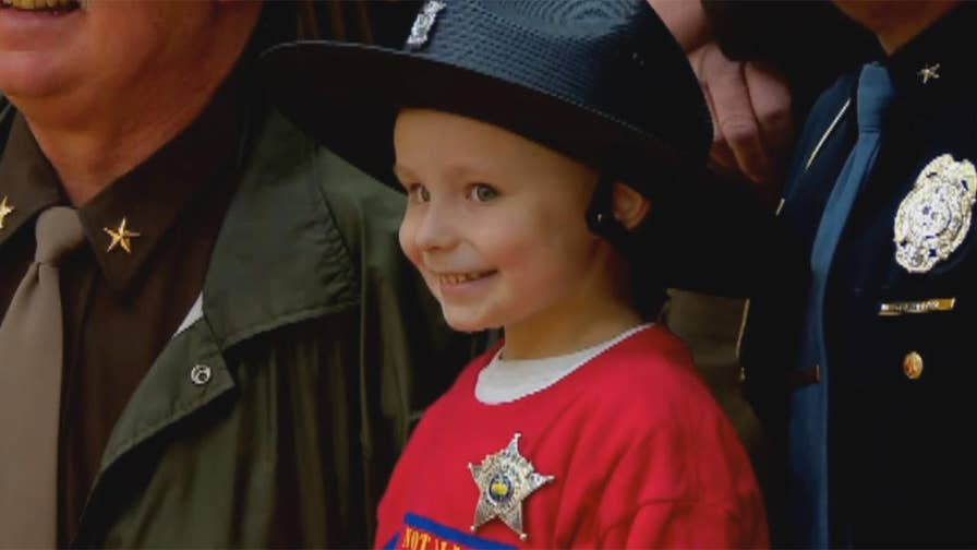 Raw video: Brantley Taber who is battling cancer for a third time and maxed out his lifetime dose of chemotherapy sworn in as honorary sheriff's deputy in Indiana.
