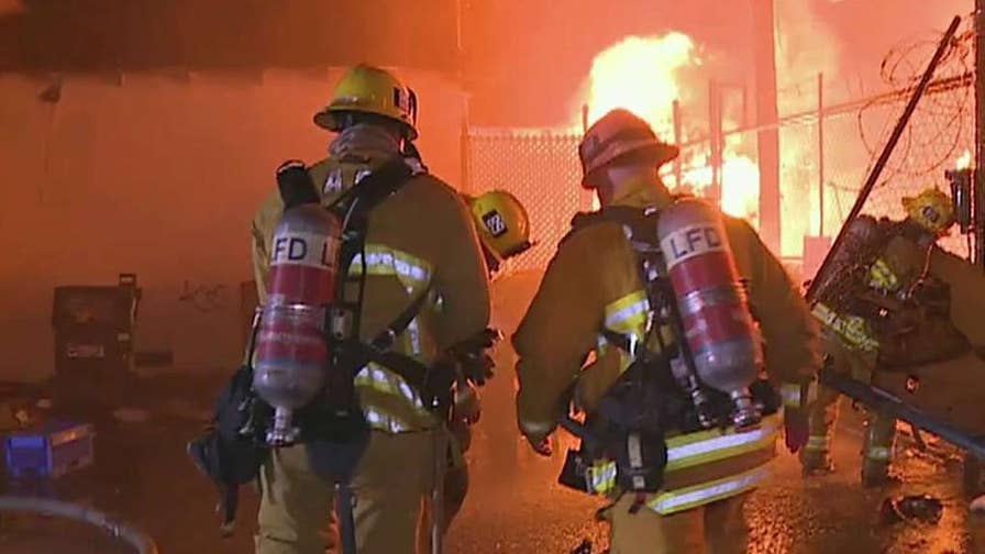 Three people suffering injuries as four apartments were destroyed in North Hollywood, California.