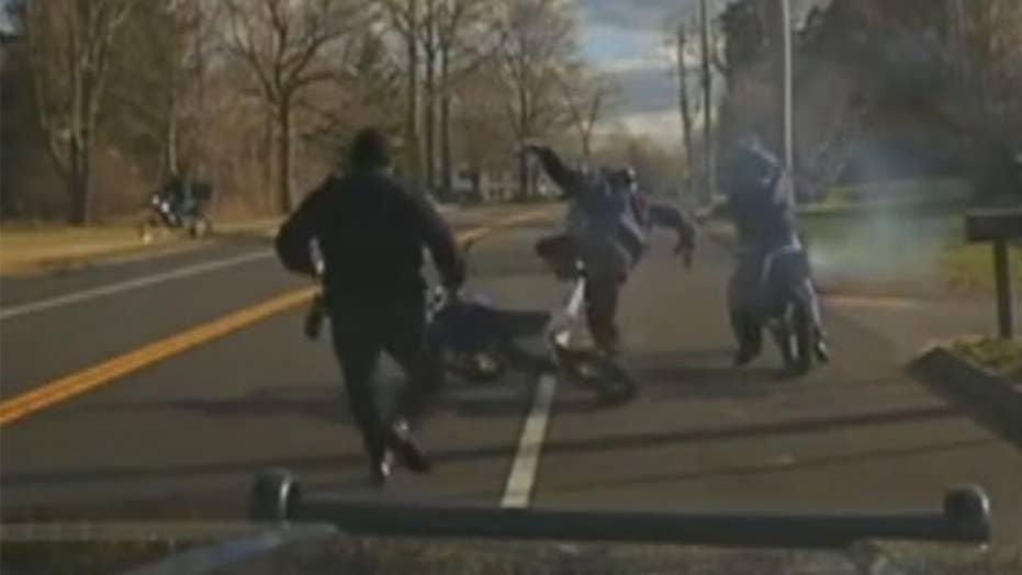 Dirt biker falls off motorcycle, hops on another to flee cop