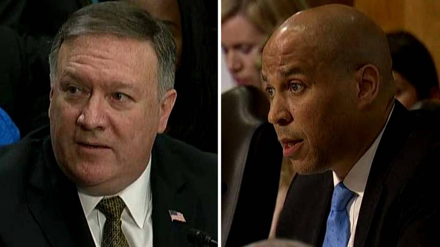 Challenged by Sen. Cory Booker at his Senate nomination hearing, President Trump's pick for secretary of state Mike Pompeo says he continues to hold the view that it is inappropriate for same-sex couples to marry, but stresses he treats all individuals with the same respect.