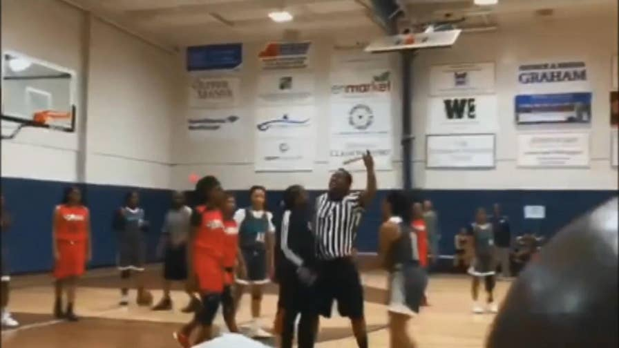 A high school basketball tournament in Savannah, Georgia erupted into chaos when the referee called a foul against one team.