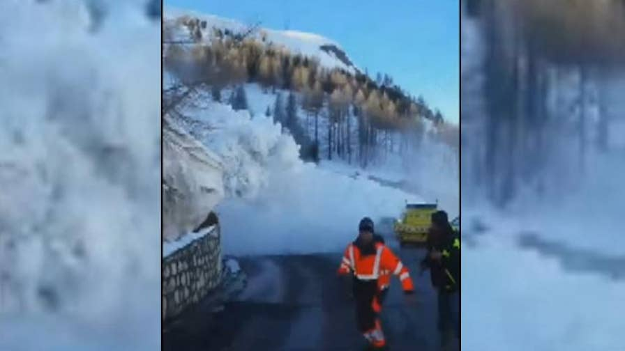 An avalanche was triggered for safety reason near Tignes, France. The snow came tumbling down the hillside, spilling onto a road and blocking a tunnel.