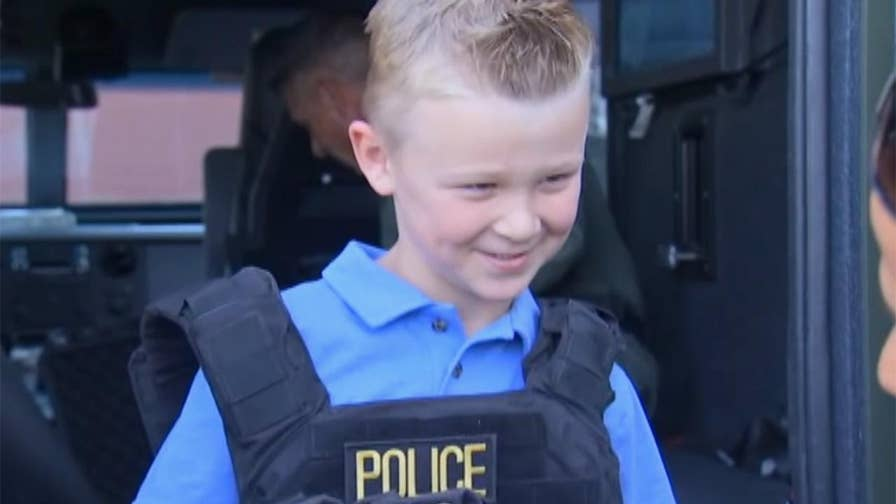 Five-year-old Grady Valen gets all-access tour of Henderson Police station as reward after donating money raised from lemonade stand to fallen cops.